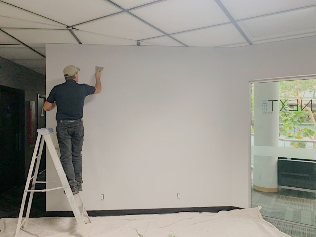 Preparing to install vinyl film on a wall
