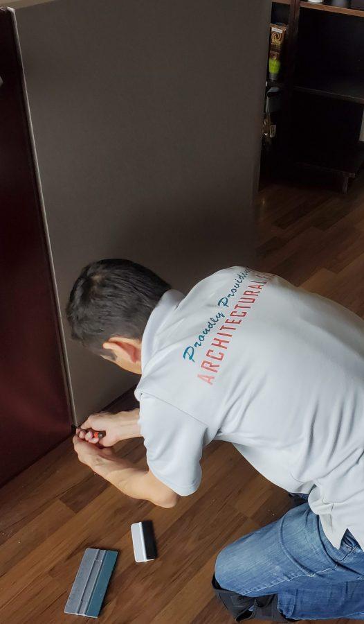 Nelcos-installer-during-reception-desk-renovation
