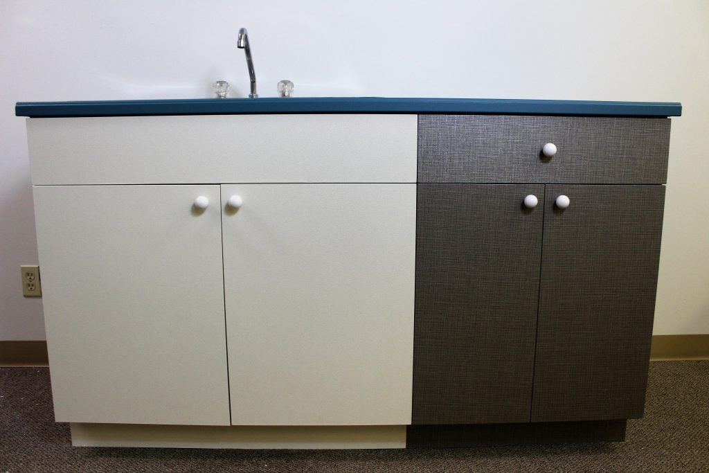 Kitchen cabinets after refinish with an architectural film